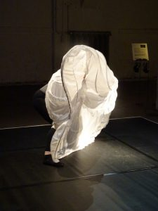 "Eva Baumann performing in ""Unsichtbare Orte"". Photo: Helen Varley Jamieson."